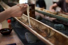 """nagashi sōmen"" (流しそうめん flowing noodles) in the summer. A long flume of bamboo across the length of the restaurant carries the noddles in ice-cold water. As the sōmen pass by, diners pluck them out with their chopsticks and dip them in tsuyu."