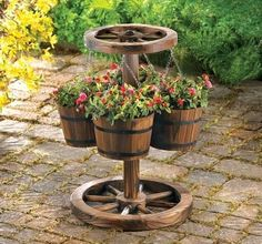 Plant Stand Wagon Wheel And Flower Pots
