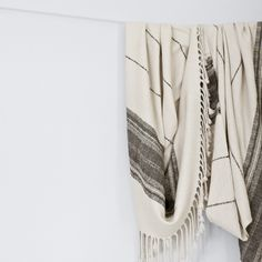 La Brisa Throw // A modern take on traditional Peruvian motifs, this hand-loomed 100% baby alpaca throw features an intricate diamond pattern with accent stripes. Rows of hand-twisted fringe lend a rustic touch to this clean, two tone textile.