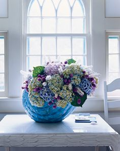 Keep your celebration cool with a Cimicifuga- and hydrangea-dominated centerpiece collected in a clay vase.
