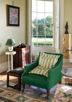 An antique HOWE London Howard chair covered in our Natural Maroc Goatskin in 'Malachite'