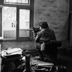 A British sniper takes aim with his .303cal rifle.