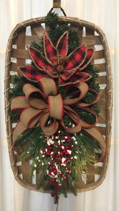 Love the poinsettia in this. Christmas Booth, Christmas Swags, Christmas Door Decorations, Holiday Wreaths, Rustic Christmas, Christmas Holidays, Christmas Ornaments, Tobacco Basket Decor, Fru Fru