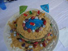 Megan's Pool Party Birthday Cake. I love using chocolate rocks. The sand was Graham Cracker crumbs.
