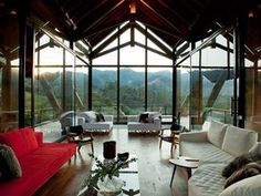 Floor-to-vaulted-ceiling windows mimic the peaks of the Mantiqueira Mountains just outside this Brazilian hotel. Take a look!