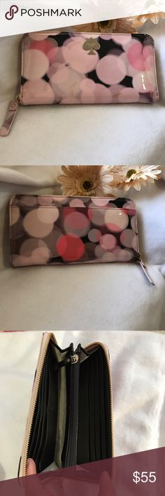💥LAST PRICE💥Kate spade pink cherry wallet Kate spade pink cherry wallet. There is some slight tan color marks at the front coz i just kept it on my closet and never used it. I dont know where it came from. But other than that it is in excellent condition. Very clean inside and no flaws. Spacious interior with tons of slot and pockets inside. kate spade Bags Wallets