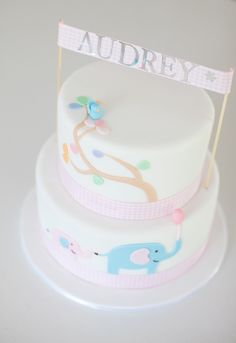 Naming day cake,  pastel elephants, handmade bunting.  Cake designed to match the invitations. Cute, simple, elegant. Would also make a gorgeous first birthday or baby shower cake!  Love thy Cake - Cake Gallery