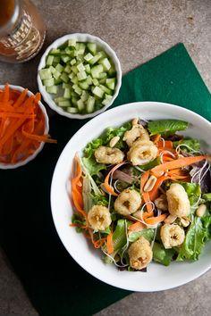 Crispy Calamari tops this satisfying salad loaded with fresh Asian flavors. Cooking Calamari, Calamari Recipes, Seafood Recipes, Squid Recipes, Seafood Dishes, Seafood Linguine, Linguine Recipes, Asian Chicken Salads, Asian Salads