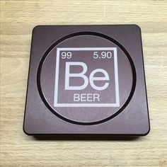 "Element of Beer. Laser engraved bottle opening coaster. A unique gift for beer lovers. ""Modern Coaster anodized in bronze."