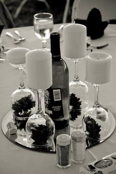 Like it but wine glasses with candle to tall.  Use snorter wine shaped glass like a corgial.  Use flameless candle wrapped in burlap.  Plus too many glasses, use three.  Sjk