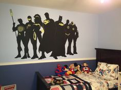 superhero mural on Charlie's bedroom wall.  The yellow parts glow in the dark.
