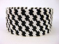 A beautiful, classic peyote bracelet! Made of Japanese delica beads in white pearl and black. It closes with a beaded toggle and a loop. This beaded bracelet is approximately long when clasped and It is for smaller wrist - if you need another length or Peyote Beading, Seed Bead Bracelets, Seed Bead Jewelry, Beaded Jewelry, Bead Earrings, Seed Beads, Peyote Patterns, Bracelet Patterns, Bracelets