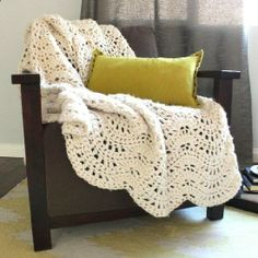 Crochet this chunky and cozy lacy throw quickly using super bulky yarn and a jumbo hook. Free pattern!