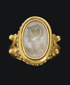 A ROMAN AGATE RINGSTONE  CIRCA 1ST CENTURY A.D. |  The flat oval stone engraved with a winged bust of Victoria in profile to the left, the hair arranged in plaits and bound in a fillet; mounted as a ring in a modern gold setting.
