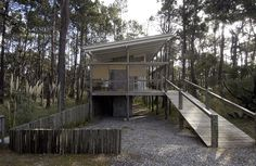 The land where this residence is part of a densely wooded, is an isolated and subject to strong natural and environmental constraints, this resulted in a project that respects the existing trees and the construction i. Simple Tree House, 21st Century Homes, Container Cabin, Forest House, Wooden Decks, Design Blog, Contemporary Design, Architecture Design, Home Goods
