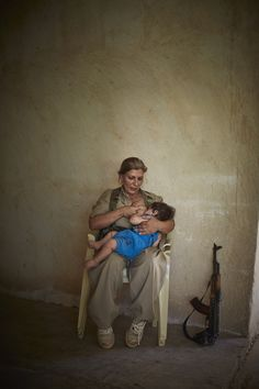 Kurdish media outlets are abuzz with a photograph of a Peshmerga woman, sitting beside an automatic weapon, breastfeeding her child. The picture has been widely distributed on social networking sites, highlighting the strength of Kurdish women and the resilience of female combatants in the ongoing fight against IS.