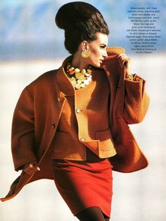 Nostalgia in the 90s: The 60s beehive-inspired hair and the classic suit from Bill Blass in autumn colors. Stunning. Photo from Harper's Bazaar, September 1990.