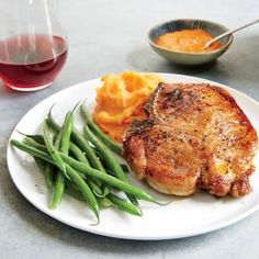 Moroccan-Spiced Pork Chops with Mashed Sweet Potatoes Recipe -- This sounds better to me with chicken substituted