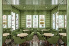 Green, luxurious dining space in Pasticceria Marchesi