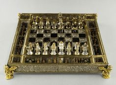 """The """"St Louis"""" chess comes from the Crown collection, but the tradition attributing it to Louis IX of France is certainly mistaken. This set, made of rock crystal and smoked quartz, was in fact created in the late fifteenth century in Germany (the board) and France (the pieces). Late 15th century & additions in the 17th century."""