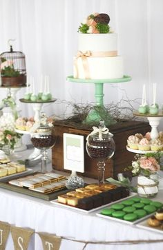Use boxes to sit dessert on for different layers. Wedding Dessert Table