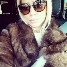 Caroline Stanbury.. Lilly e Violetta faux fur, Valentino sweater, and Prada glasses..