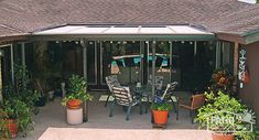 Sandstone patio cover with glass roof panel for added light exterior