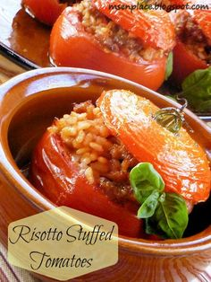 Risotto stuffed tomatoes.   6 beef tomatoes 1tbsp olive oil, plus extra for greasing.  15g butter 5 spring onions, trimmed and sliced. 175g risotto rice. 3tbsp chopped flat leaf parsley extra for sprinkling. 125 reduced fat mozzarella, drained and cut into small cubes. 60g parmesan grated,