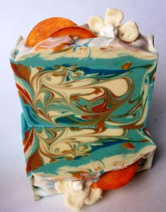Melt & pour glycerin soap nectarine slices and cold process soap blossoms for the top