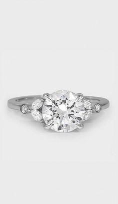 nature-inspired ring features four dazzling marquise shaped diamonds