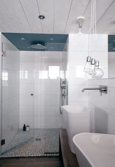 White bathroom with a see-through shower stall