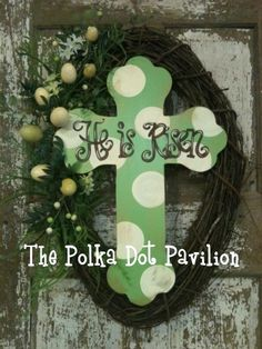"A wreath idea for Easter. Include a cross in the middle of a grapevine wreath with the words ""He is Risen""."