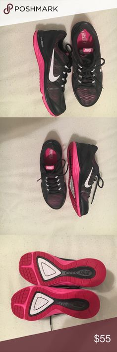 Nike dual fusion shoes Nike Dual Fusion women's shoes.  Pink and black with white Nike emblem.  Never worn. Size 8.5 Nike Shoes Athletic Shoes
