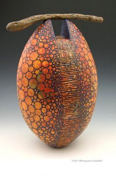 melanie ferguson. I love this GORGOUS vessel. I love the way you brought nature into this vessel.  It is FABULOUS......