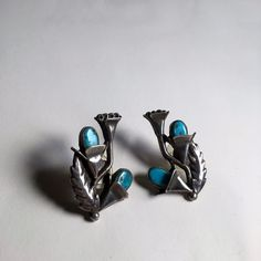 """Up for grabs is this stunning pair of true vintage Navajo earrings. Having dealt in a lot of Native American jewelry from out West, I can honestly say that this pair of earrings stands out as very unique. They are handmade from sterling silver and natural turquoise. They measure approximately 1.75"""" x 1"""". Excellent condition. 