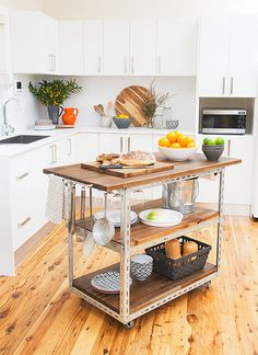 Make It: DIY Industrial Kitchen Island » Curbly | DIY Design Community this is what I am imaging we can do with a discarded teen computer desk.......