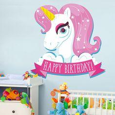 """Vinilo decorativo infantil con la imagen de un unicornio. en el se puede ver una banda con la frase """"Happy Birthday"""". Una muy buena opción para colocar en una fiesta de cumpleaños."""