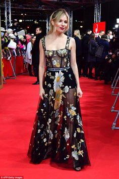 Stealing the spotlight: Sienna Miller flashed her nipples as she arrived at the Berlin Film Festival premiere of The Lost City Of Z on Tuesday night