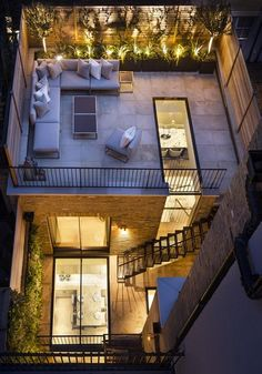 roof top terrace at night with lighting | adamchristopherdesign.co.uk