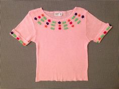 1970's shortsleeved pink acrylic knit sweater by brinkdwellers, $24.00