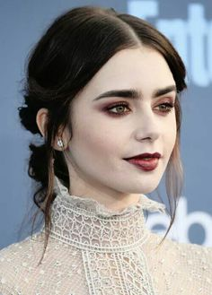 """Lily Collins attends The 22nd Annual Critics' Choice Awards at Barker Hangar on December 11, 2016 in Santa Monica, California.  """"Victorian vampire chic."""""""
