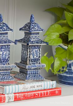 Style a bookshelf with porcelain pagodas for a hint of Chinoiserie.