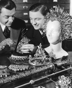"""Eugene Joseff and his brother Jimmy Glaser looking at their wares. The huge acrylic headpiece was worn by Virginia Bruce in 1936's """"The Great Ziegfeld."""""""