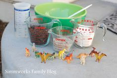DIY Kids Crafts: DIY Dinosaur Fossils  What You'll Need:  1 cup flour  1 cup dirt  1/2 cup sand (play sand works the best)  1 cup water  12 tiny plastic dinosaurs  Plastic wrap-lined cookie tray  What you do:  1. Dump the flour, dirt, and sand into a bowl.