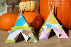 Tiny paper teepees! Use them as place cards, or just as adorable homemade Thanksgiving decorations. I love the colors!