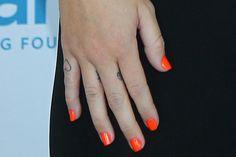Miley Cyrus finger tattoos