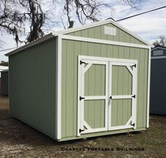 Coastal Portable Buildings Garden Shed 10x16 painted with SW Sage with white trim and roof. #coastalportablebuildings #gardenshed #backyardliving