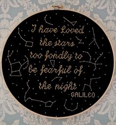 A custom cross stitch made on commission of the stars and constellations. Made with black Aida cloth and metallic DMC thread.