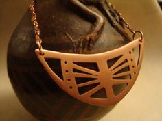 Wonderful Etsy listing at https://www.etsy.com/listing/111642910/copper-necklace-with-hand-sawn-plate-as