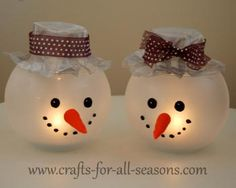 Snowman Candle Holder {Tutorial} The snowman holds a votive candle inside, and is made from a small glass fishbowl that you can buy at any craft store. The bowl is spray painted with frost paint, which creates a beautiful glow when the candle is burning inside. Its face is painted on with black glass paint, and a carrot nose is made from polymer clay. Its hat is made from craft wire mesh.
